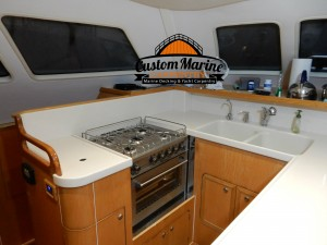 look this Boat Kitchen the Corian Counter Top by Custom Marine Carpentry